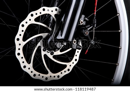 Bicycle disc brake. Front disc brake on mountain bike - stock photo