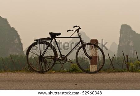 Bicycle, hills, Yangshuo, China - stock photo