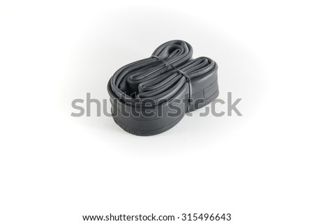 bicycle inner tire tube on white background - stock photo