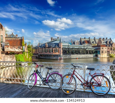 Bicycle is very common and popular transport in Europe. Bicycles in european town street. Ghent, Belghium - stock photo