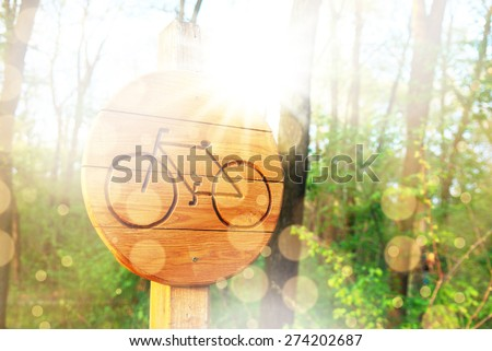 Bicycle lane sign indicating bike route wooden - stock photo