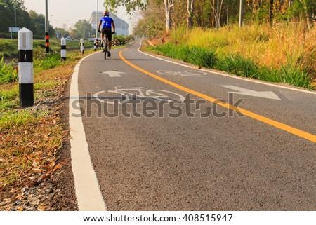 Bicycle lane signage on asphalt road - stock photo