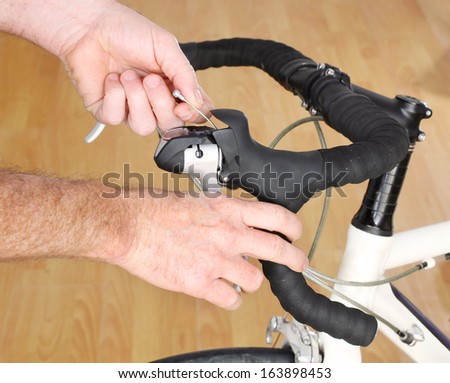 Bicycle Maintenance-replacing the brake cable on a road bike - stock photo
