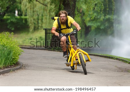 Bicycle messenger with cargo bike speeding for delivery - stock photo