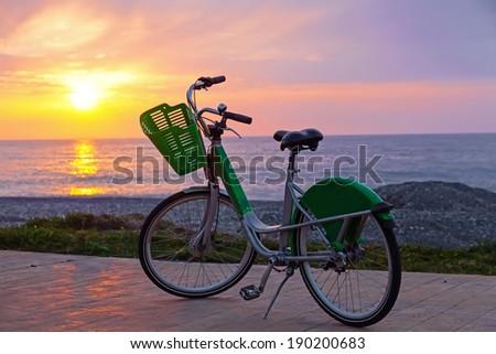 Bicycle on Batumi beach, sunset  - stock photo