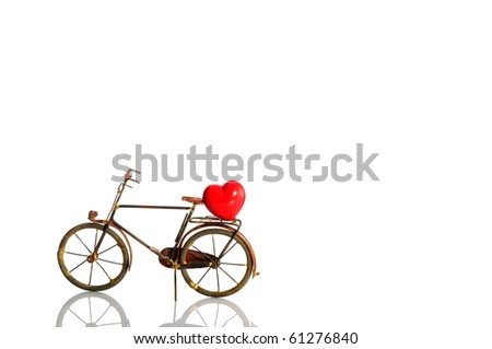 Bicycle over white with red heart - Love cycling concept - stock photo