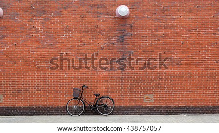 Bicycle parking in front of Brick Wall - stock photo