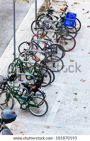bicycle parking on a city sidewalk - stock photo