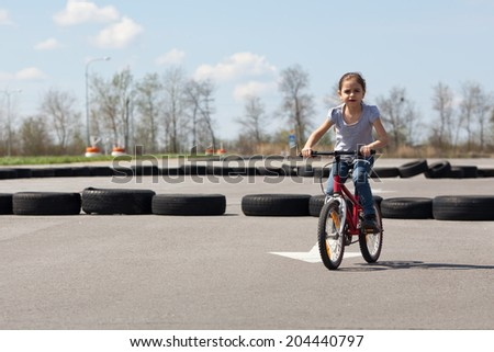 Bicycle racing fast around the track - stock photo