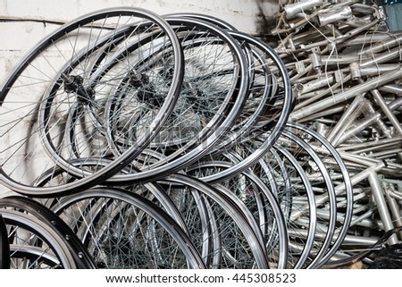 Bicycle rims in row in manufactory house. - stock photo
