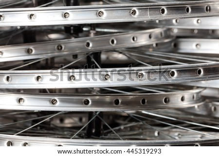 Bicycle rims piled up in workshop. Wheel manufacturing - stock photo