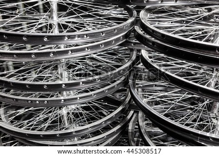 Bicycle rims put in rows in wheels manufacturing - stock photo