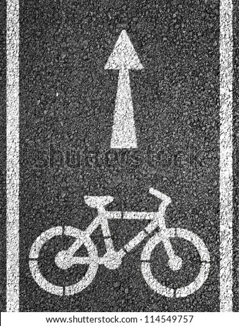 Bicycle road sign and arrow - stock photo