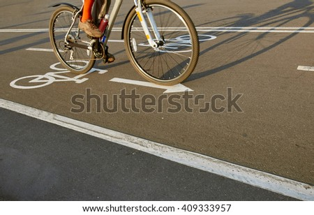 Bicycle road sign and bike rider - stock photo