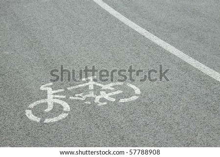 Bicycle road sign painted on the pavement - stock photo