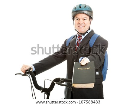 Bicycle salesman or missionary handing you a copy of the bible.  Isolated on white. - stock photo