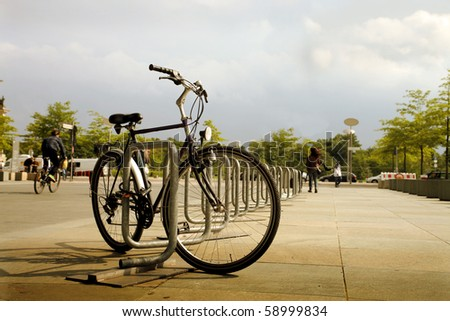 Bicycle secured on a parking in a city - stock photo