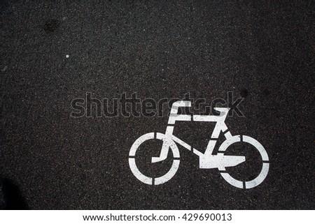 Bicycle sign. Bicycle Lane. Bicycle lane signage on street. Bicycle sign path on road, bikes' lane on outskirts or urban area. Bicycle lane signage on street. - stock photo