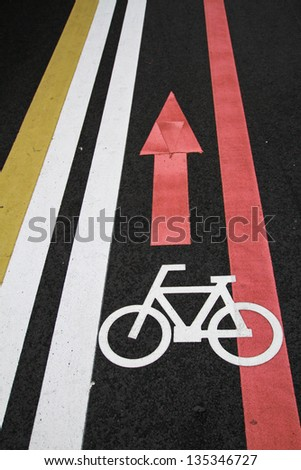 Bicycle sign path on the road - stock photo