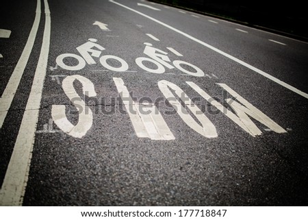 Bicycle sign SLOW - stock photo