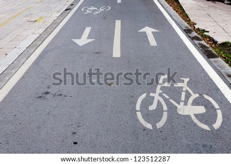 Bicycle signs on the streets - stock photo