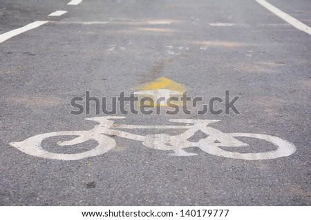 Bicycle symbol on city street - stock photo