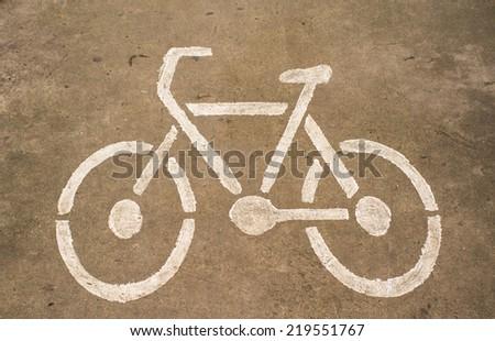 Bicycle symbol on street - stock photo