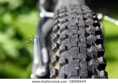 Bicycle tyre tread close-up - stock photo