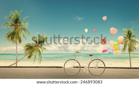 bicycle vintage with heart balloon on beach blue sky concept of love in summer and wedding honeymoon - stock photo