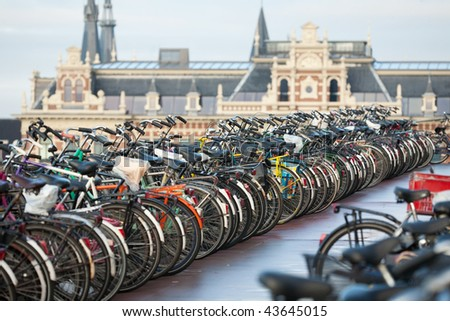 Bicycles in Amsterdam in front of the central station - stock photo