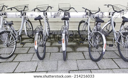 Bicycles on a parking healthy transport, sport in the city, environment - stock photo