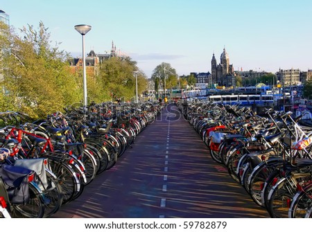 Bicycles on parking in Amsterdam (Netherlands) (Stitched Panorama) - stock photo