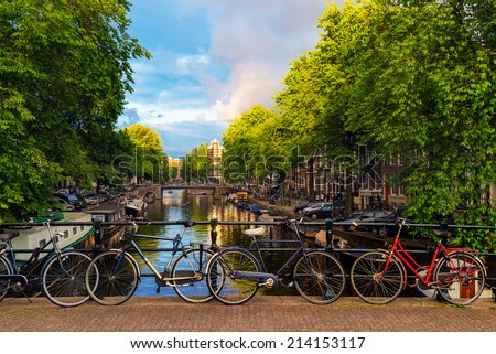Bicycles Parked Along a Bridge Over the Canals of Amsterdam, Netherlands - stock photo