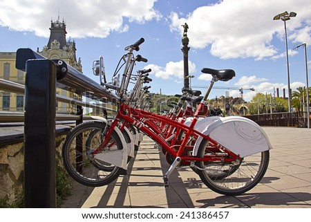 Bicycles rental service in Barcelona (Spain), on the street - stock photo