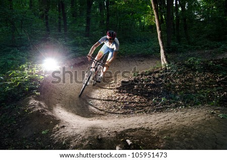 bicyclist bikes in the forest - stock photo