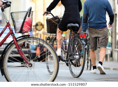 Bicyclist in traffic - stock photo