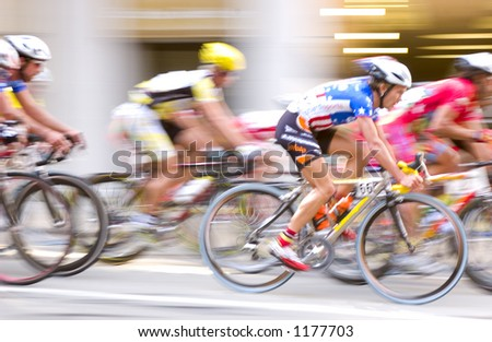 Bicyclist Race In Motion Blur - stock photo
