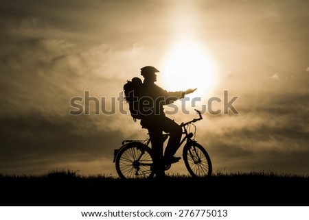 bicyclists and sunrise - stock photo