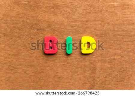 bid colorful word on the wooden background - stock photo