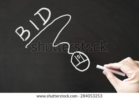 Bid word and mouse sign drawn on the blackboard using chalk - stock photo