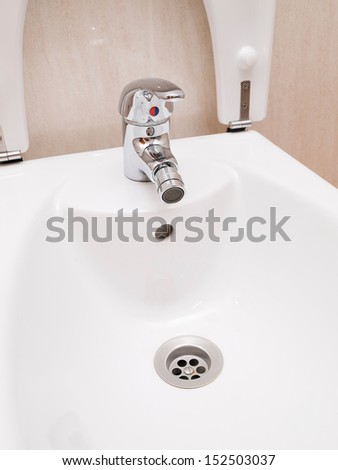 Bidet detail with tap and drain - stock photo