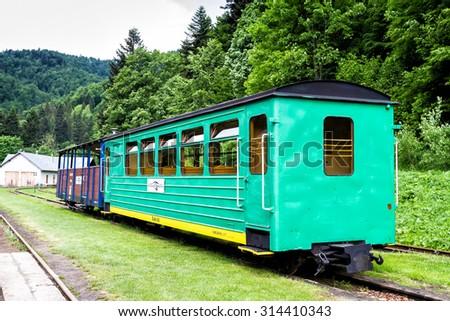BIESZCZADY, POLAND - JUNE 3: Narrow-gauge railway, steam train. Tourist train rides in summer from Cisna to Przyslup in Bieszczady mountains, Poland on June 3, 2015. - stock photo