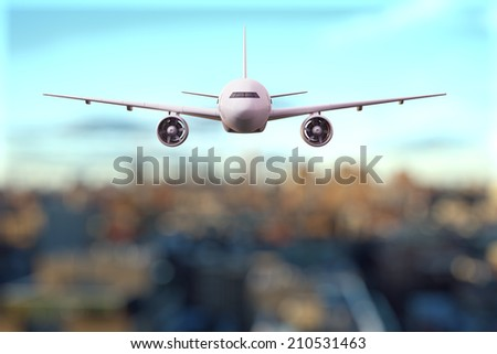 big airplane flying over the city - stock photo