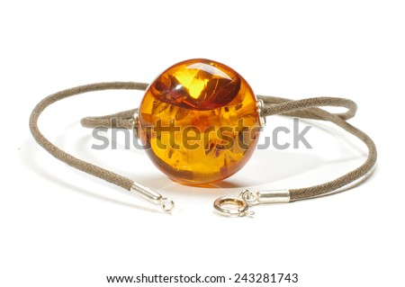 Big amber charm isolated on the white background - stock photo