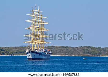 Big Ancient Ship In Blue Deep Sea. High quality stock photo. - stock photo
