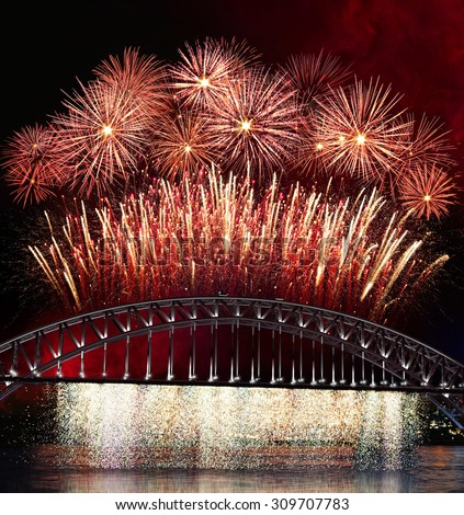 Big and bright fireworks explosions over the Sydney Harbour  bridge. Celebration concept with massive fireworks display.  - stock photo
