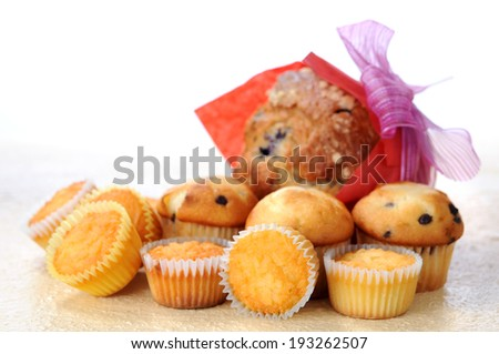 big and mini muffins on table  - stock photo