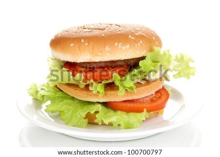 Big and tasty hamburger on plate isolated on white - stock photo
