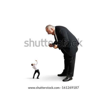 big angry boss screaming at small startled worker. isolated on white background - stock photo