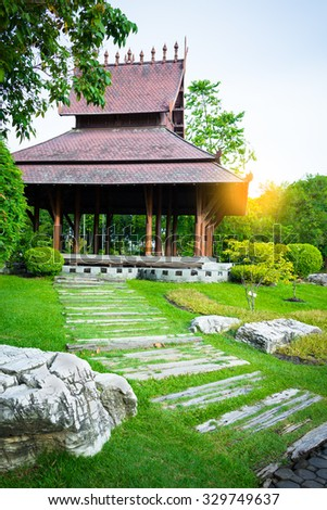 big asian country style pavilion & sunset in beautiful garden - stock photo